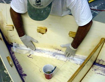 Fiberglassing is easy: a piece of fiberglass is wetted out with resin ...